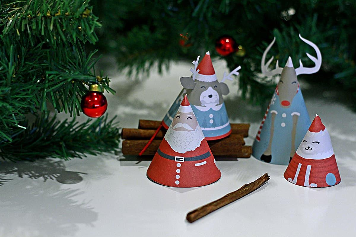 Christmas printables around a cinnamon fire