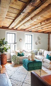 farmhouse look created with a shabby chic linen sofa cover