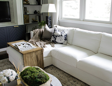 sectional couch in a white linen couch cover