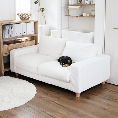white linen slipcover on a square arm sofa