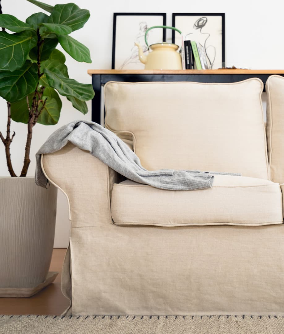 Undyed natural linen sofa covers on a round arm sofa
