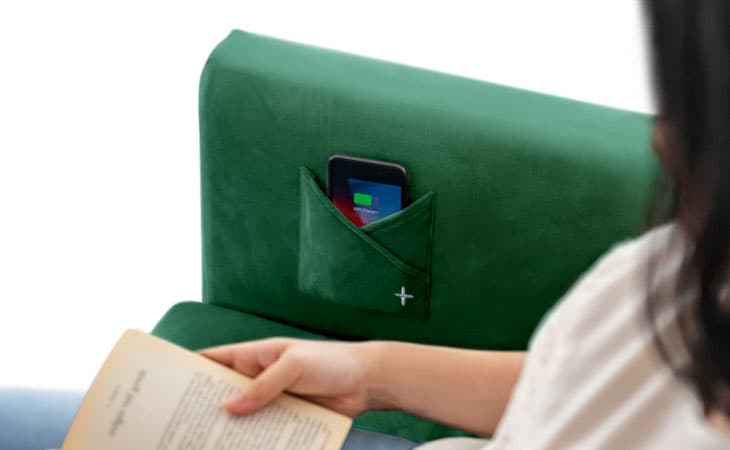 Close-up of Wireless Charge pouch, made by Comfort Works in green velvet (Rouge Emerald).