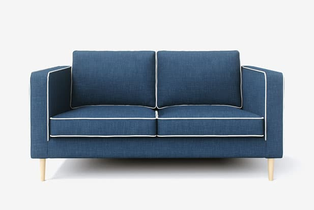 example of Coupe Sereée + Gaia White Tuyau de contraste sofa cover with Kino Denim fabric