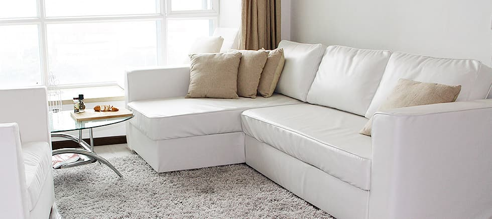 IKEA Manstad slipcovered with Modena White leather from Comfort Works
