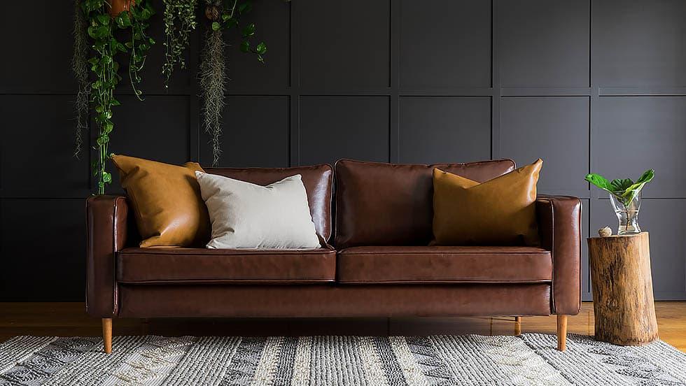 IKEA Karlstad 3 Seater Sofa Covered in Urbanskin Chestnut Leather Slipcover by Comfort Works