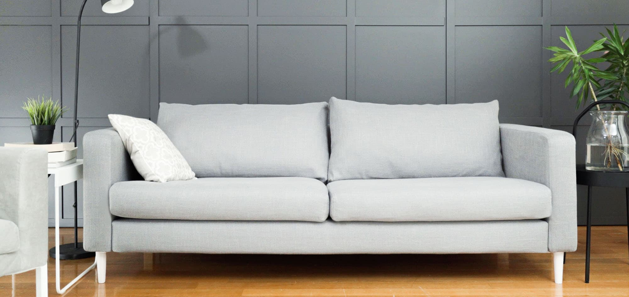 Grey Karlstad sofa cover with white legs