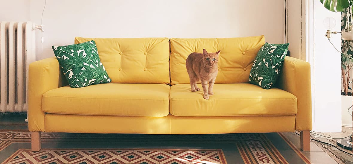 Karlstad Sofa with a yellow sofa cover and tufting
