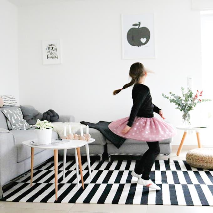 girl dances at living room