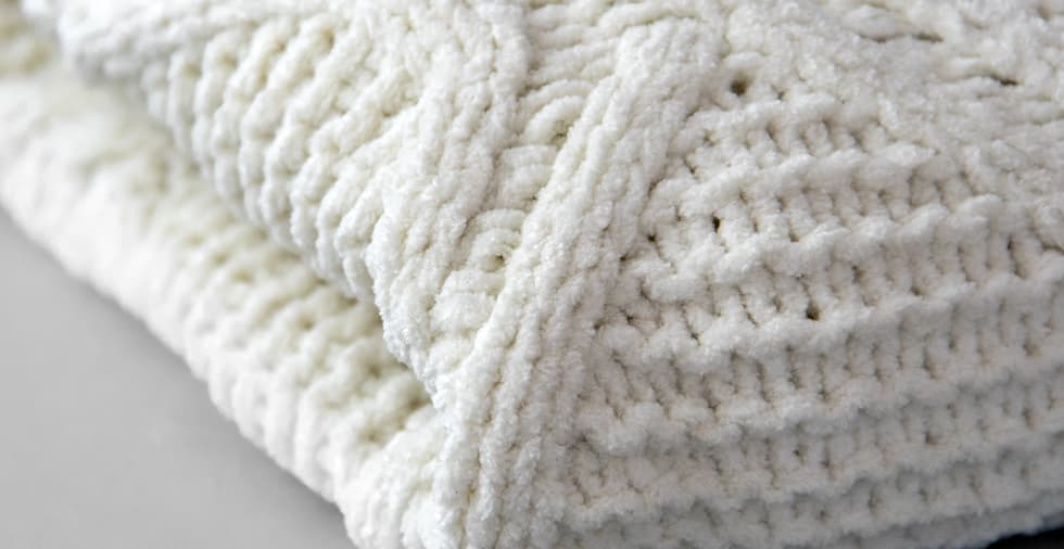 Noelle Knitted Throw Blanket with Pompoms